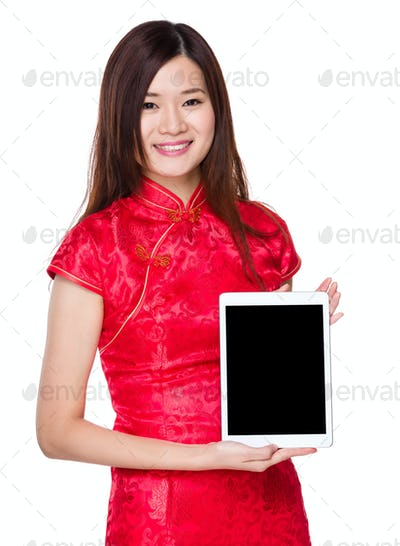 Woman show with blank screen of tablet
