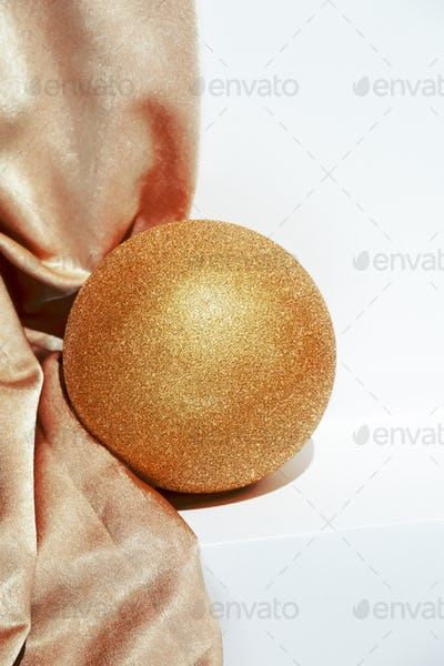 Golden textile and ball. Holiday,christmas,  concept. Still life new year wallpaper