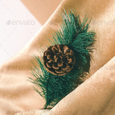 Golden textile and spruce branch decor. Holiday,christmas,  concept. Still life new year wallpaper