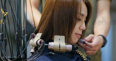 Woman perm her hair in salon