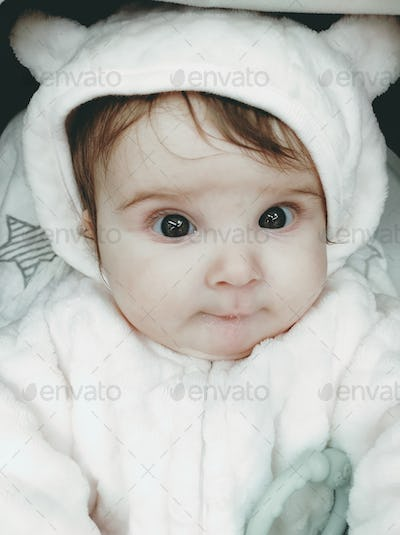 Lovely portrait of a baby girl wearing winter clothes