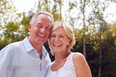 Portrait Of Loving Senior Couple In Garden At Home Together