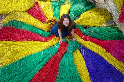 Top view of Asian traveler female making the traditional vietnam mats in the old traditional village