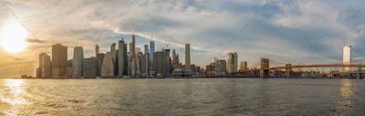 Banner and Panorama of New york Cityscape with Brooklyn Bridge over the east river at the evening
