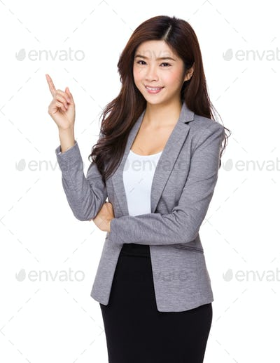 Young asian business woman pointing on copy space