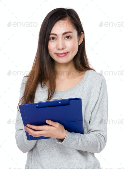 Pretty woman hold with clipboard