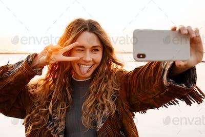 Woman taking a selfie by smartphone