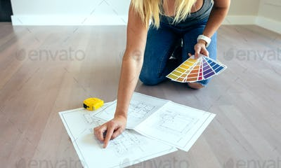 Young woman looking house plans