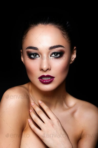 beautiful brunette girl model  with bright makeup
