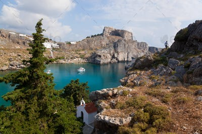 St Pauls Harbour, beach and Acropolis, Lindos Rhodes Greece