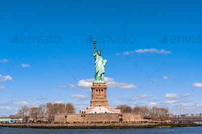 The Statue of Liberty under the blue sky background, Lower Manhattan, New York City,