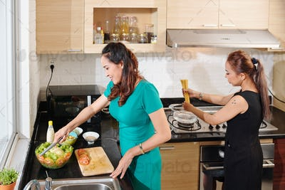 Women cooking dinner at home