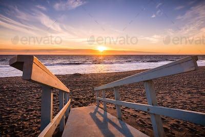 Sunset on one of Malibu's sandy beaches, the Pacific Ocean coastline, Los Angeles county, California