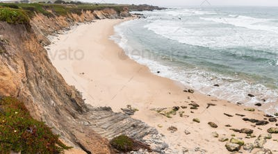 Sandy beach on a cloudy day on the Pacific Ocean coastline, Pescadero State Beach, California