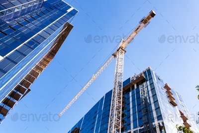Crane and skyscrapers under construction in San Jose, South San Francisco bay area