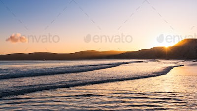 Sunset view of the Pacific Ocean shoreline, Drakes Beach, Point Reyes National Seashore, California
