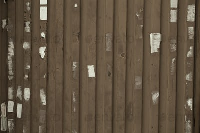 Wooden wall or fence with poster remnants