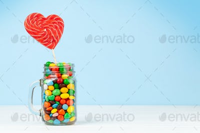 Various candy sweets and heart shaped lollipop