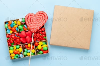 Various candy sweets and heart shaped lollipop. Valentines day gift box