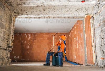 Construction Worker Inside Newly Rebuilt Building Interior