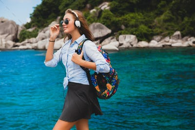 young stylish hipster woman traveling around the world