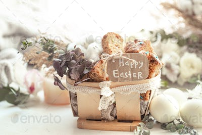 Happy Easter composition with pieces of Easter cake in a decorative basket and eggs.