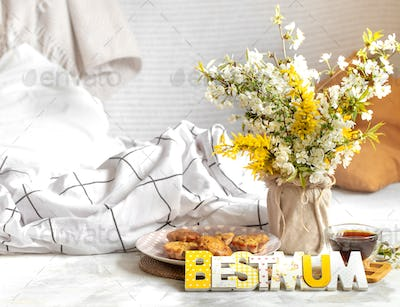 Mother's day holiday, cozy background composition with flowers .