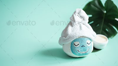 Creative Spa concept .Coconut with a face mask.
