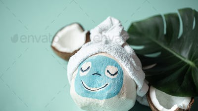 Creative Spa concept .Coconut with a face mask .