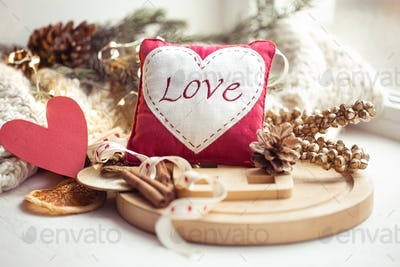 Cozy decorative home still life with the word Love, garland and decor details.