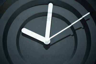 Decorative stylish modern black wall clock. Close up.