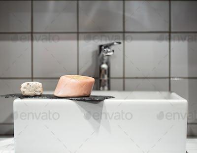 Bathroom with soap near the washbasin. Hygiene and care
