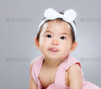 Baby girl making funny face