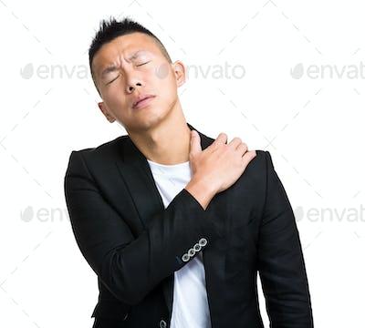 Businessman with shoulder pain