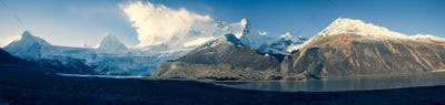 LandscapePanorama view of beautiful glacier lagoon and snow mountains in Tibet,China