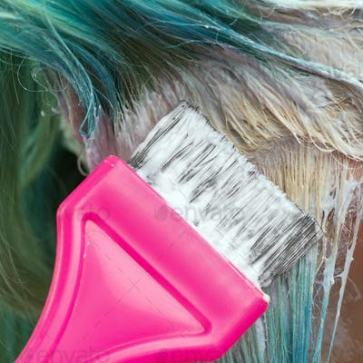Hairdresser Applying Paint to Emerald Hair Color During Process of Bleaching Hair Roots