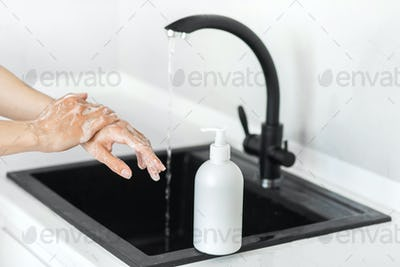 Prevention of coronavirus. Washing hands with soap and use antiseptic