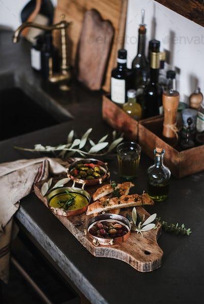 Traditional Mediterranean meze appetizers platter over kitchen counter