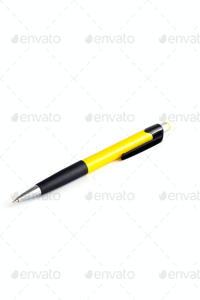 yellow pen over white background