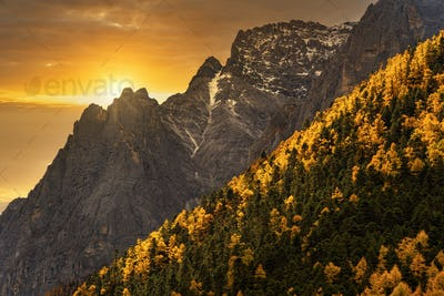 Scene of sunset at The mountain in autumn season in yading nature reserve, Daocheng County,