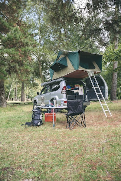 Offroad 4x4 vehicle with tent in roof ready for camping
