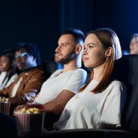 Couple enjoying free time in movie theater