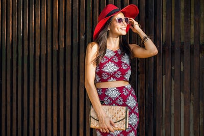 stylish beautiful woman in printed outfit, summer style fashion