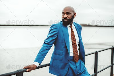 African man in a stylish blue suit