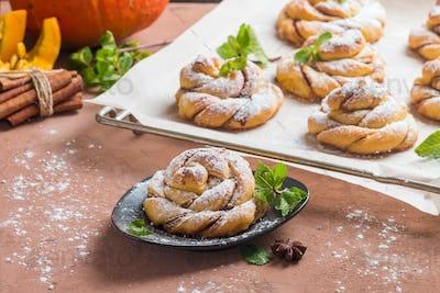 Homemade cinnamon buns with pumpkin