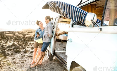 Young couple on relax moment at vintage minivan roadtrip