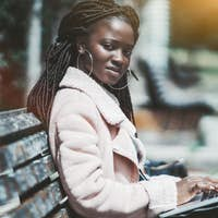 African girl with laptop outdoors
