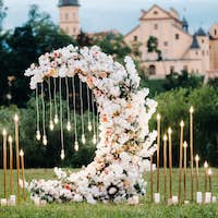 Wedding ceremony on b street near the Nesvizh castle.Decor with fresh flowers in the form of the