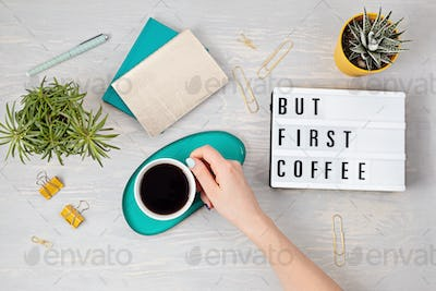 Flat lay with lightbox with text But first coffee and coffee cup