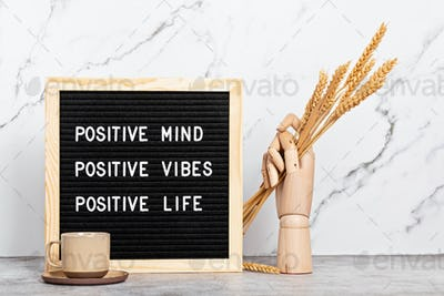 Positive mind, vibes, life motivational quote on the letter board. Inspiration text